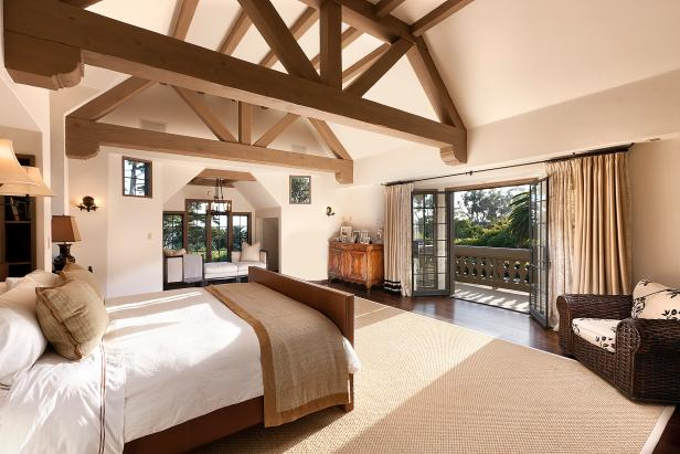 Wood beams bring warmth and texture to this bedroom