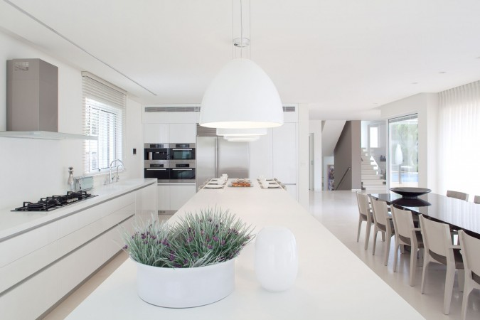 Pure white makes this minimalist kitchen glow