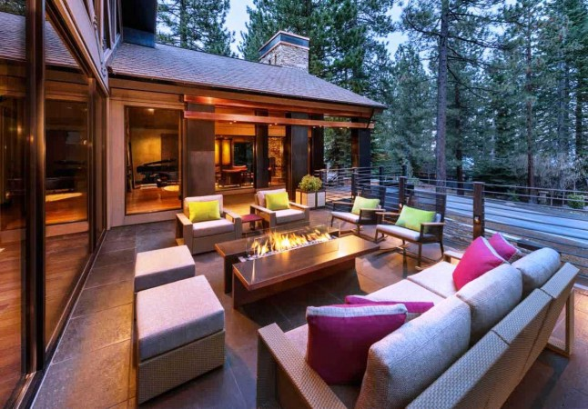 Lots of seating and comfortable cushions enhance this outdoor living space