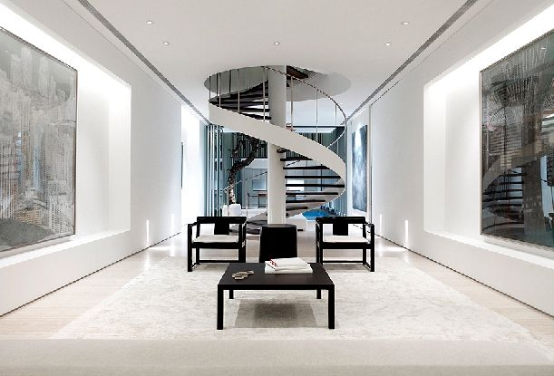Curving staircase is the focal point in this minimalist interior