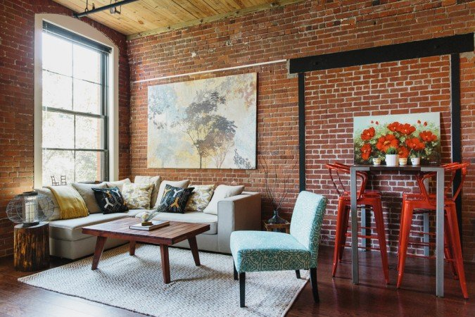 Warm red tones of brick walls enhance this space