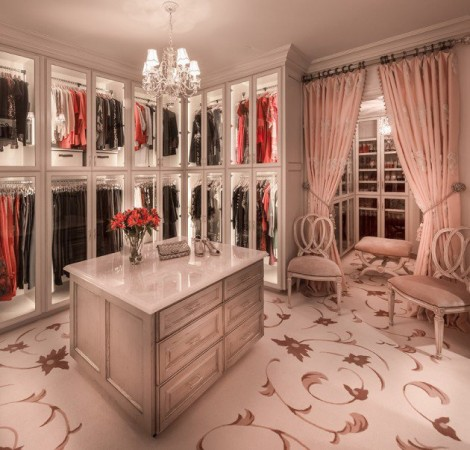 This walk-in closet is appointed with glamour