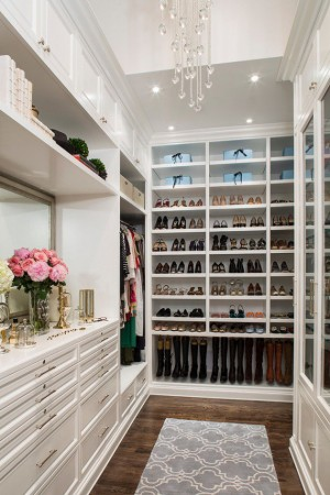 Shelving and cubbies offer space for everything in the walk-in closet
