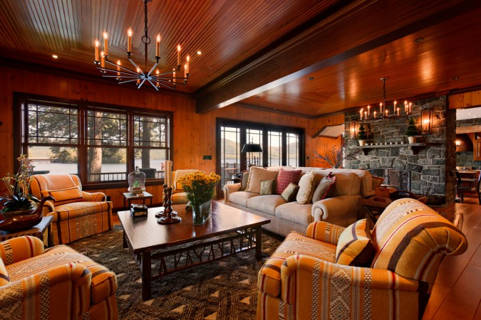 Warm wood tones and soft lighting make this space cozy for fall