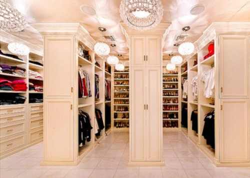 This luxury walk-in closet offers plenty of space
