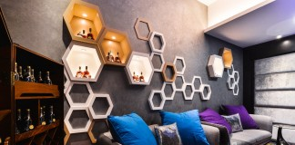 Unique honeycomb shelving adds dimension to this room