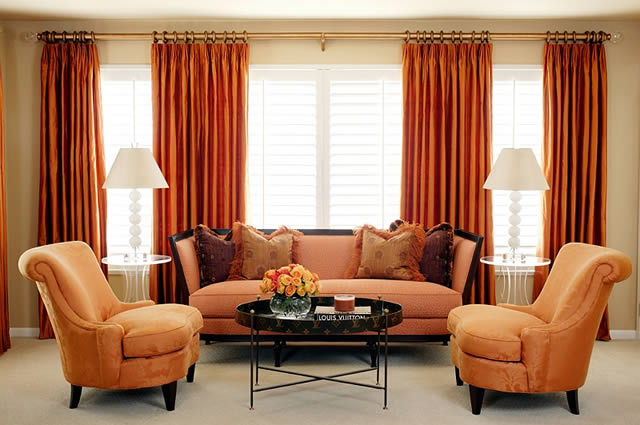 Burnt orange accents this living room