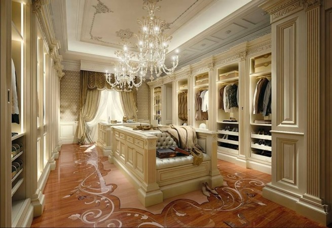 Beautiful lighting, seating and architectural details in this walk-in closet
