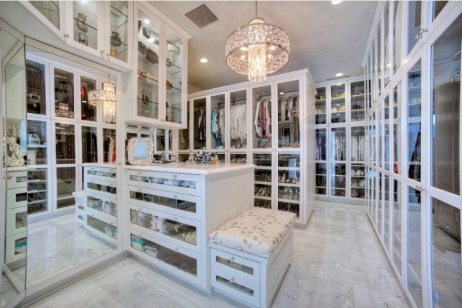 Luxury walk-in closet has plenty of storage