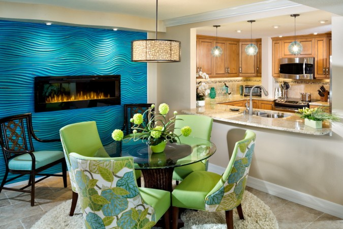 Bright blue textured wall panel brings a splash of color to this dining area