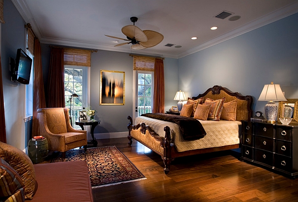 The glow of warm woods highlight this blue bedroom