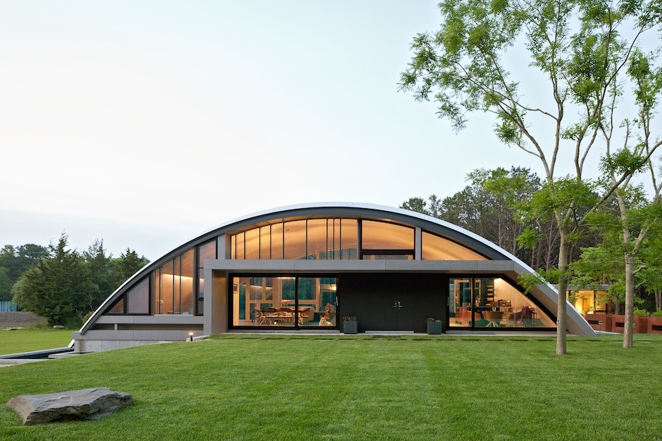 homes above and below airplane hangar and underground homes