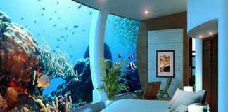 awesome bedroom built under the water in an aquarium