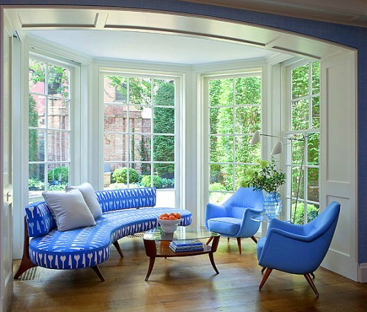 Beautiful blue fabrics enliven this seating area