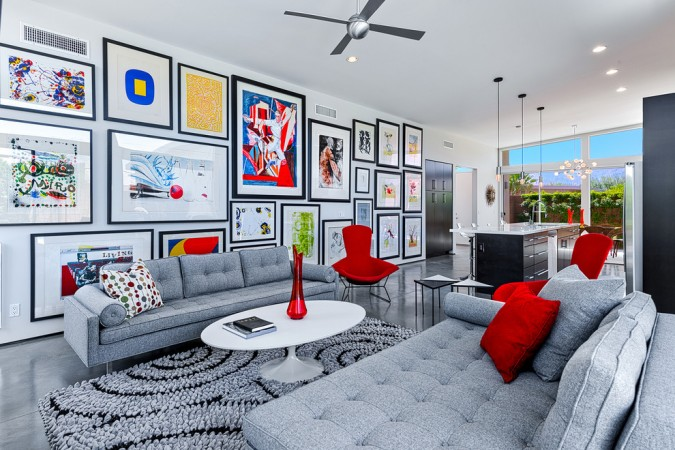 Gallery walls and pops of color balance this room