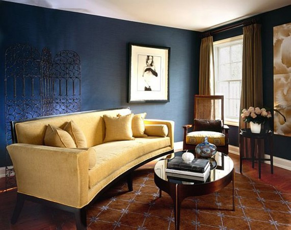 Gold sofa brings a bright touch to this brown and blue interior