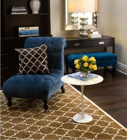 Blue chair accents this brown and blue room