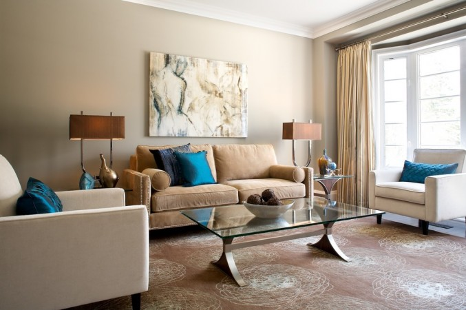 Pops of blue highlight the neutral room