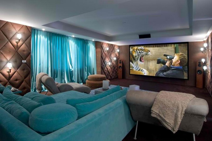 Bold aqua sofa highlights this room