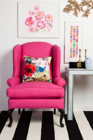Bright fuchsia fabric enhances this wing chair
