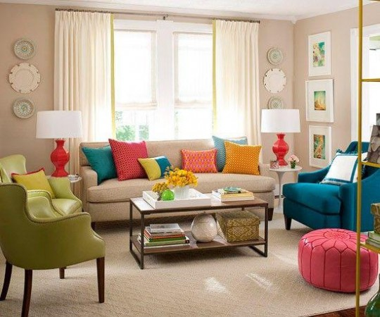 Colorful upholstered accent pieces, pillows, lamps and artwork spark this living area