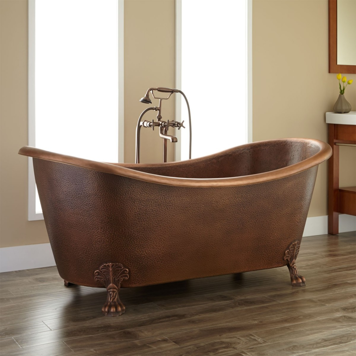 The elegance and charm of the clawfoot bathtub for Copper claw foot tub