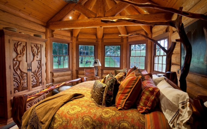 Cozy warm wood glows in this beautiful lodge bedroom