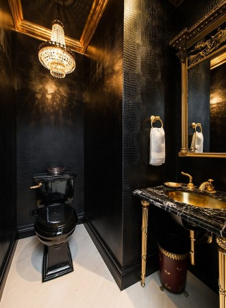 Elegant black and gold powder room