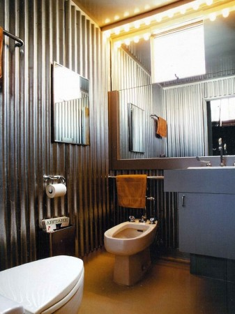 Corrugated metal bathroom gleams