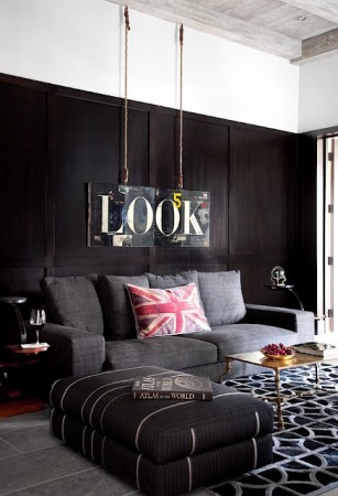Black walls give this room drama and chic sophistication