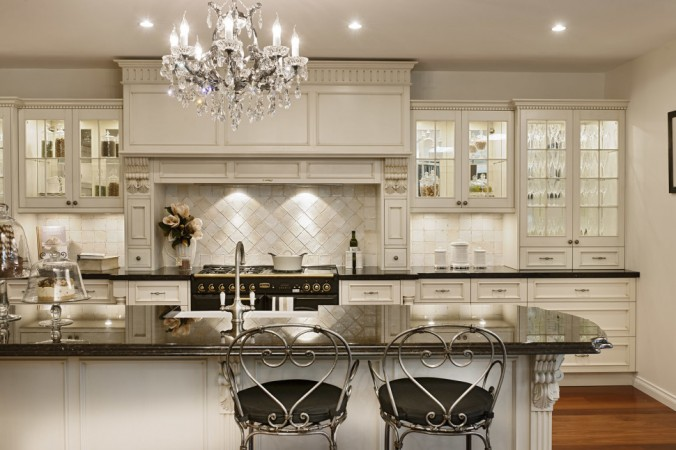 Elegant kitchen with traditional wood range hood