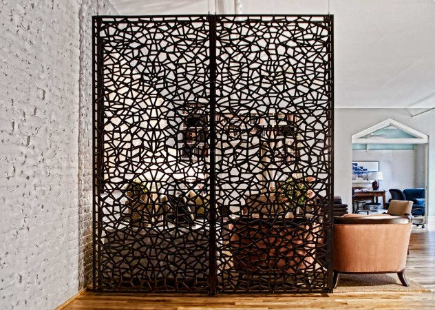 Intricate design of this room partition adds to this interior