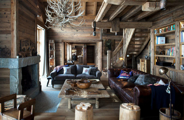 An antler chandelier tops off this lodge interior