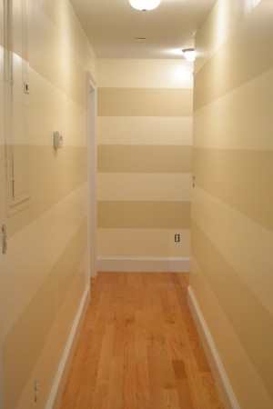 modern hallway decorated with horizontal stripes wall paper