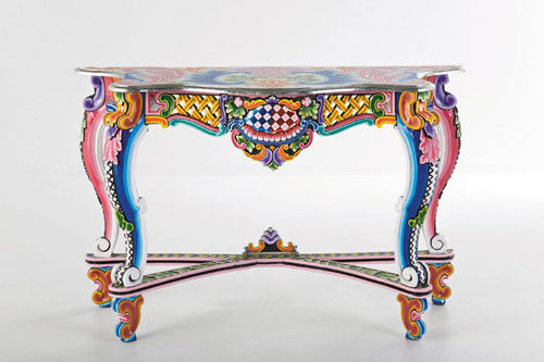 Vibrant paint brings new life to this table. Give New Life to Old Furniture With Paint