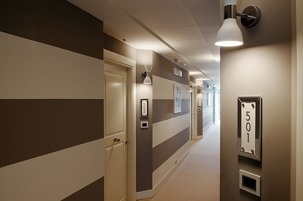 striped wall papers can make the corridor seem larger