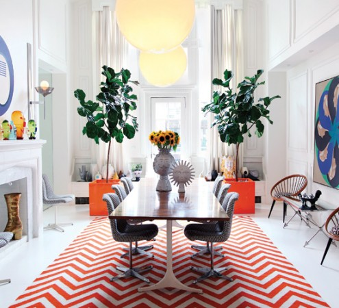 Open and spacious room pops with color and originality via designer Jonathan Adler