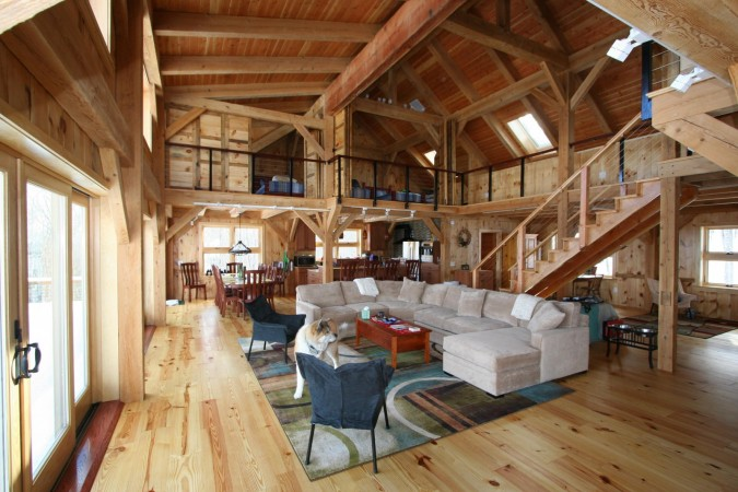 Open space and wood timbers mark this lodge interior