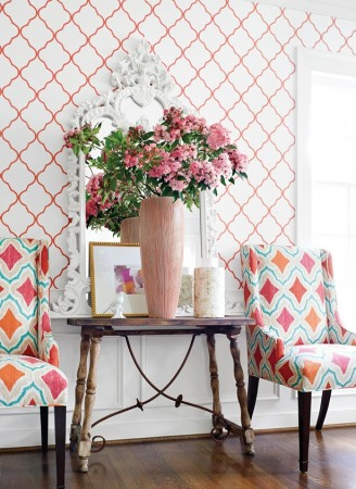 Bright geometric upholstered chairs enhance this space