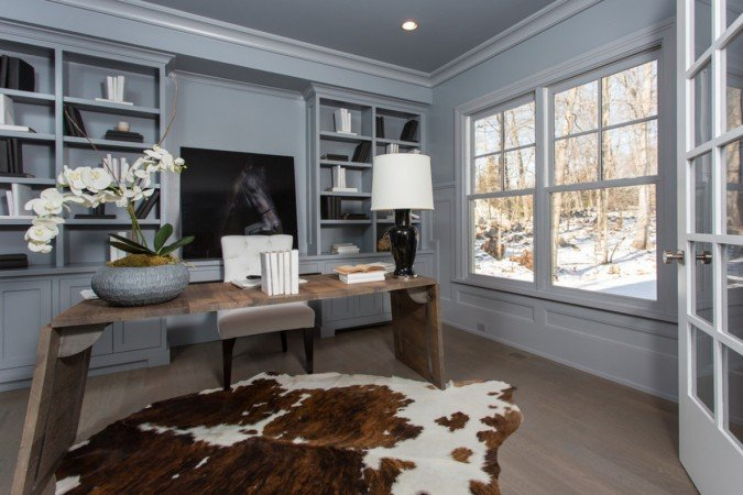 Unique desk and hide rug give this home office high style