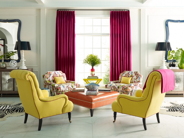 Mix bright upholstered pieces with floral and contrasting window panels