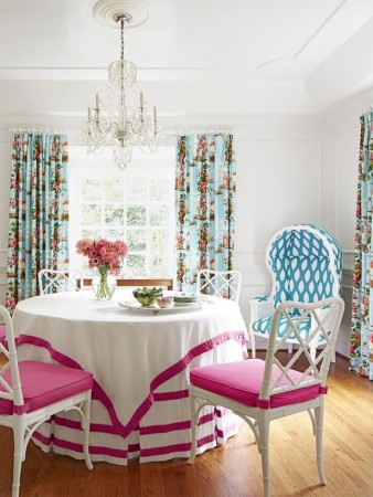 Bright fuchsia seating contrasts with blue floral panels