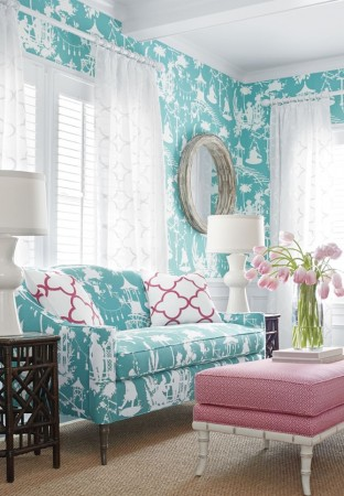 Pretty patterned upholstery brightens up this room