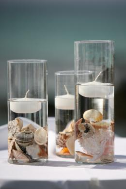 Floating candles over seashells (lovetoknow).