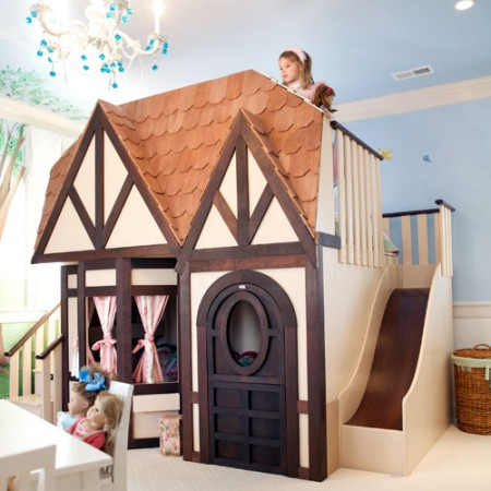 Adorable cottage themed room with a bed inside the cottage and loft on top (poshtots).