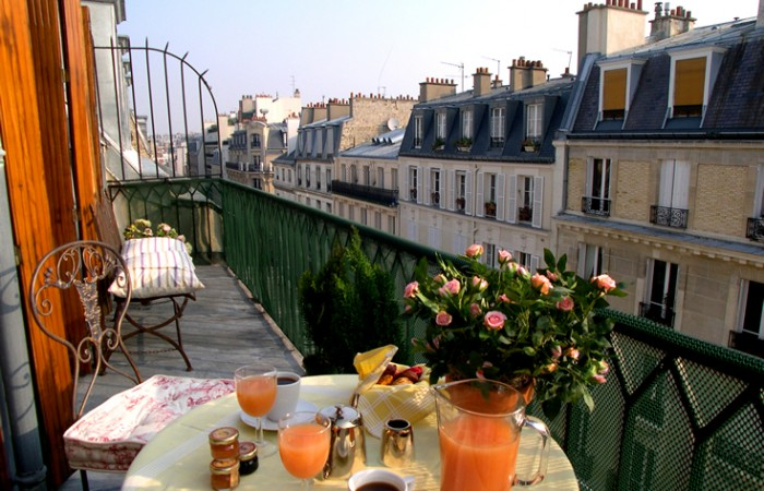 Breakfast on the balcony of a Paris apartment