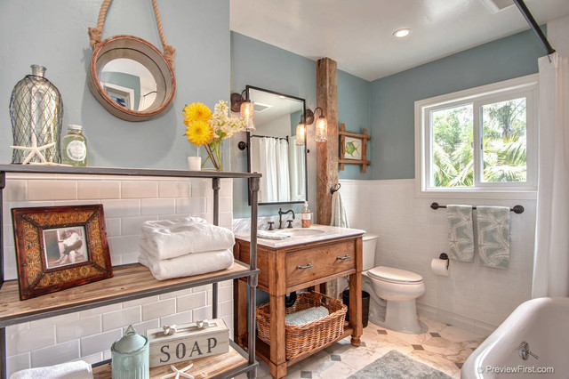 Ocean themed bathroom with wood accents (beachbathrooms).