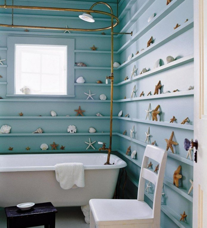 Seaside bathroom with blue shelving holding various sand dollars, seashells, and sea-creatures (evangels).
