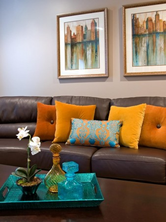 Bright throw pillows add a pop of color and texture to this living room