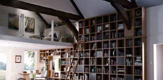 A wall of bookcases is the focal point in this interior